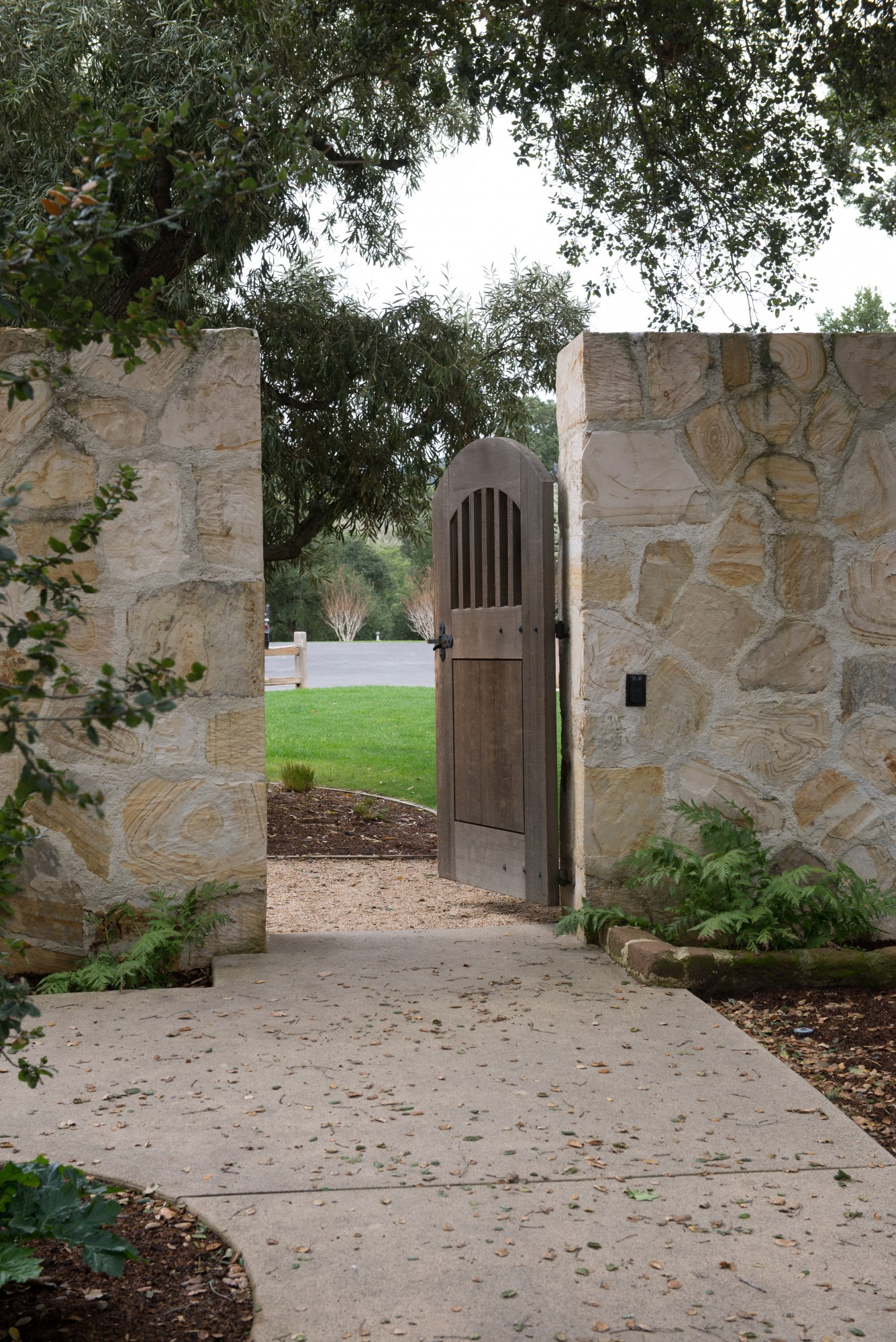 Holman Ranch, California winery, California coast wedding venue, arched wood door