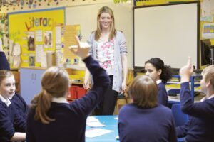 teacher in a classroom with students