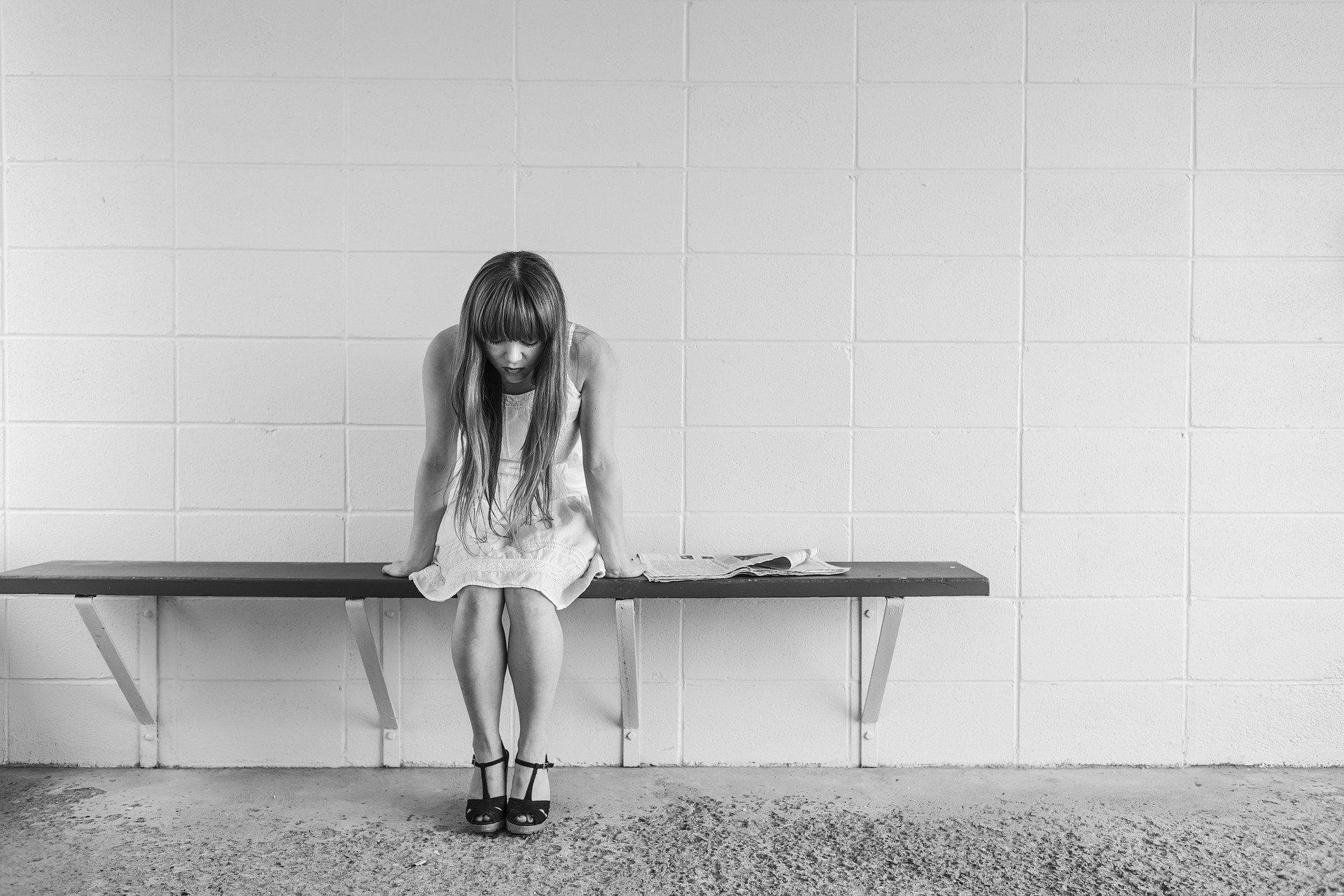 sad girl on bench