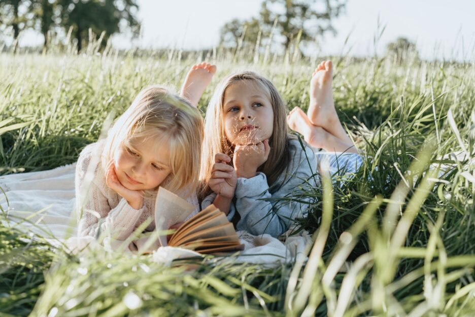 kids lying in the grass
