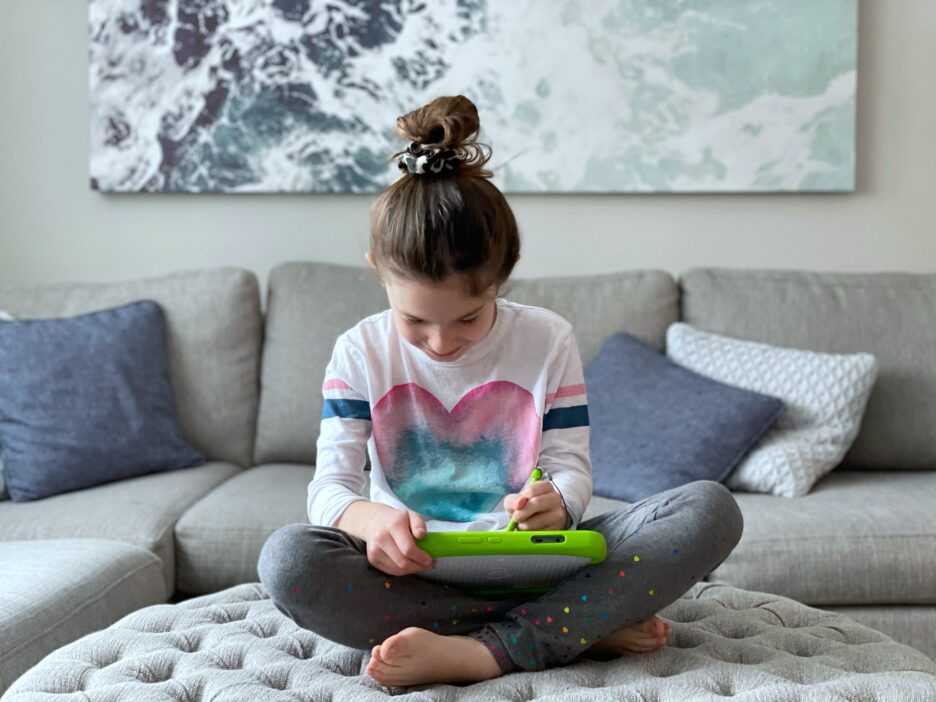 Girl playing on Leap Frog Tablet