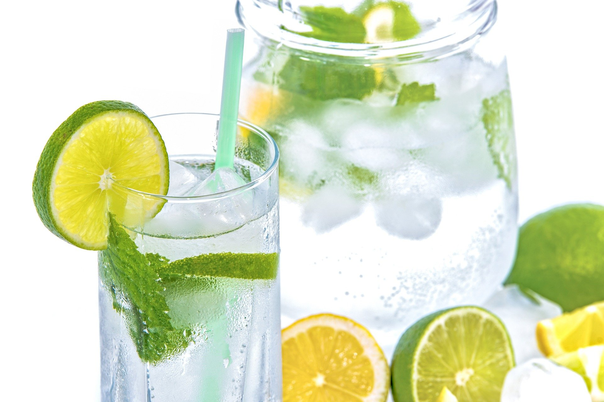 Glass of water with lemons and lime