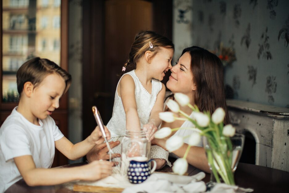 mom with two kids at the kitchen table