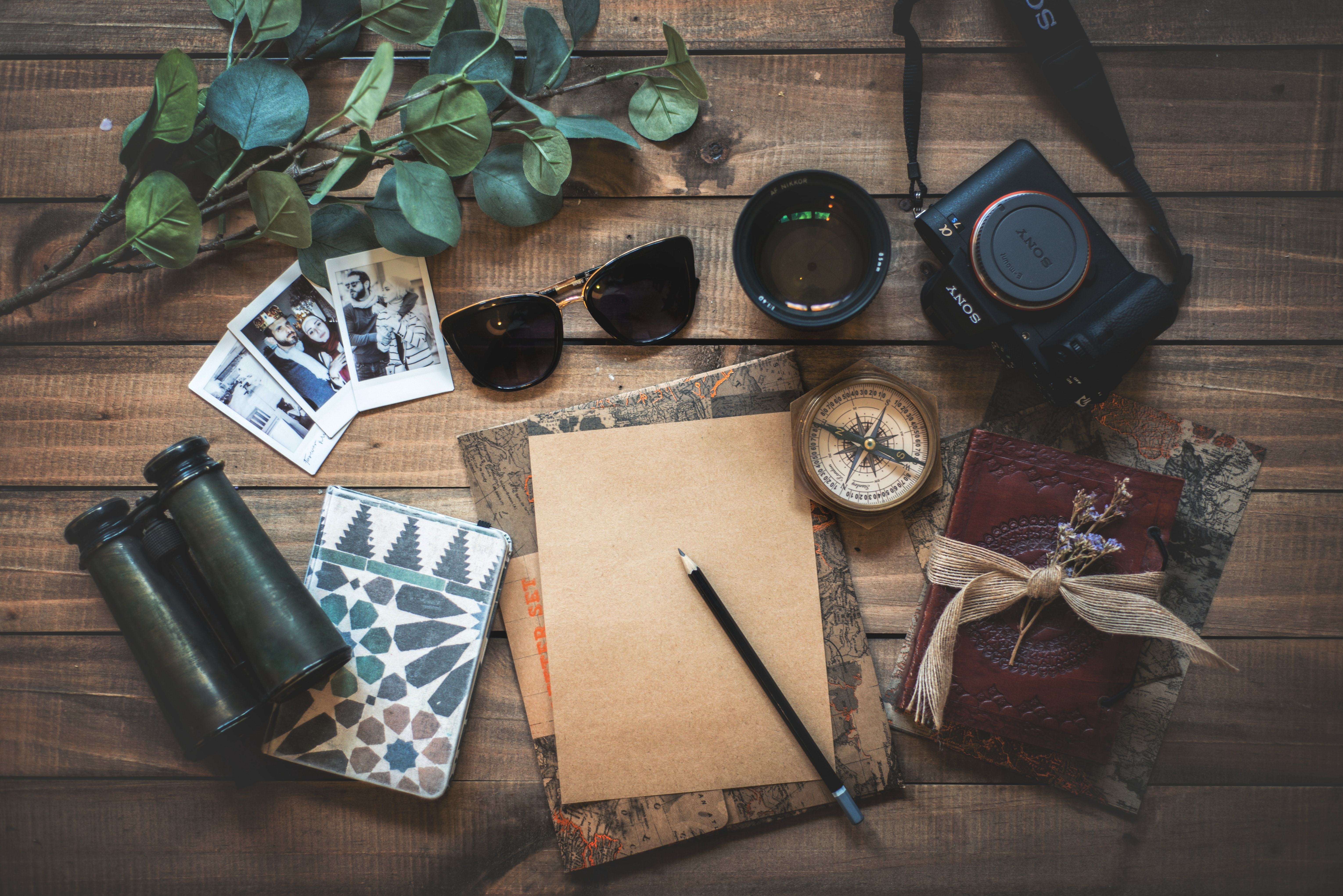 camera, notebook, sunglasses